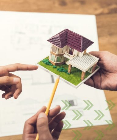 looking at a mini model of a home| What You Need to Know About Home Inspections and Home Appraisals